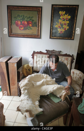Santo Domingo Dominican Republic Ciudad Colonial Calle Sanchez upholsterer job trade furniture padding stuffing - Stock Image
