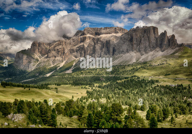 Beautiful view on the italian mountains of Val Gardena in summer season seen from path near Sella Pass with sky - Stock Image