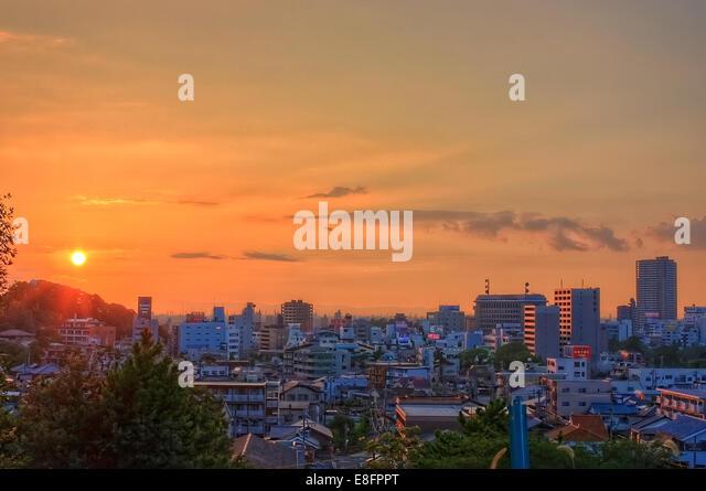 Japan, Chita, Okazaki, Sunset over Okazaki Japan making sky orange - Stock Image
