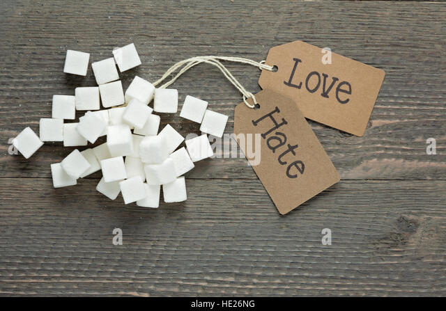 Love versus hate for sugar - Stock Image