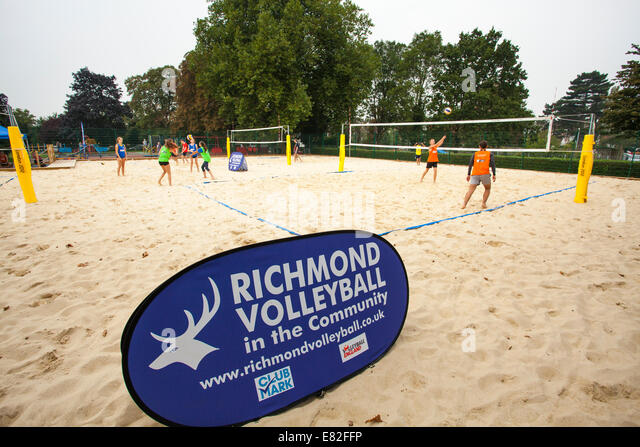 People playing on Richmond beach volleyball court. - Stock Image