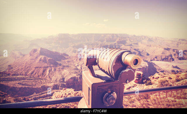 Vintage toned telescope pointed at Grand Canyon, travel concept, USA. - Stock Image