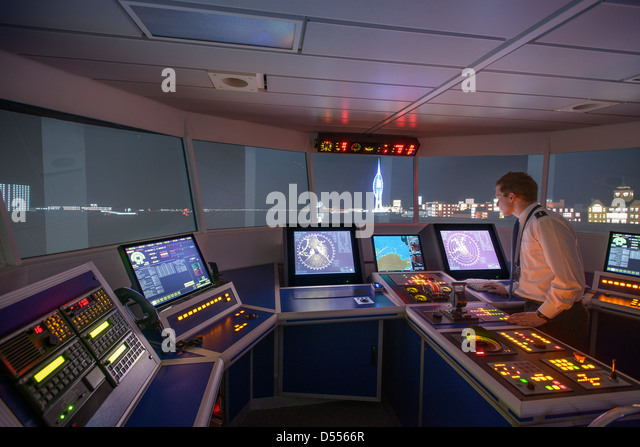 Personnel working on ships bridge - Stock Image