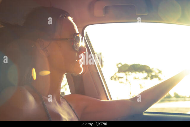 Woman Driving Car Looking out of Window - Stock Image
