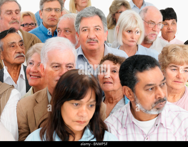A group of serious looking people - Stock Image