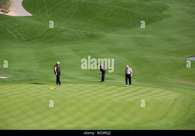 Golfers play on a municipal golf course near Palm Springs, California - Stock Image