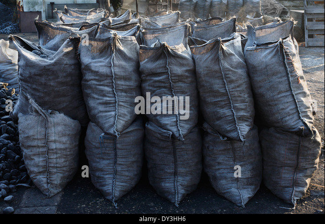 Sacks of coal in a coal yard. - Stock Image