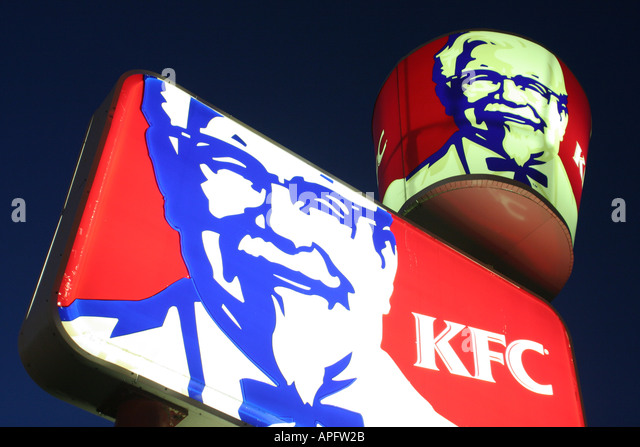 Michigan Otsego KFC Kentucky Fried Chicken lighted sign advertising Colonel Sanders - Stock Image