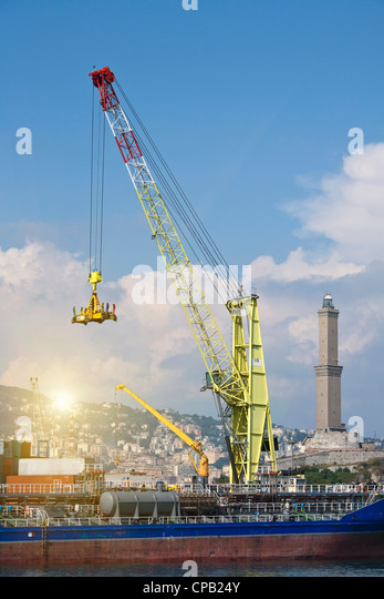Crane on barge in pier - Stock Image