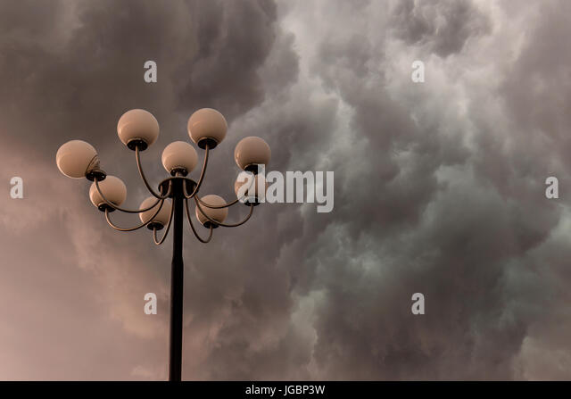 Lightning Flashes Stormy Clouds Over Big, Glorious Street Lamp   Stock Image