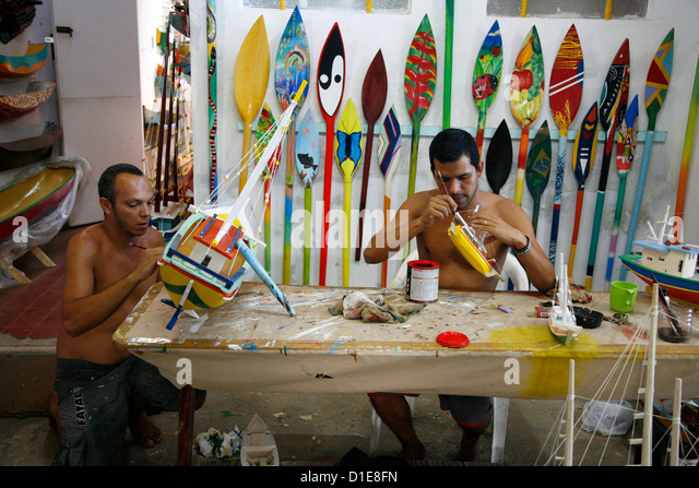 Artist at a local workshop making wooden boats as souvenirs, Parati, Rio de Janeiro State, Brazil, South America - Stock Image