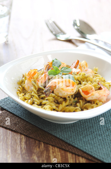 Pasta with pesto sauce and prawn - Stock Image