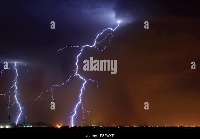 USA, Arizona, Maricopa County, Hassayampa, Lightning striking in farming area near little town - Stock Image