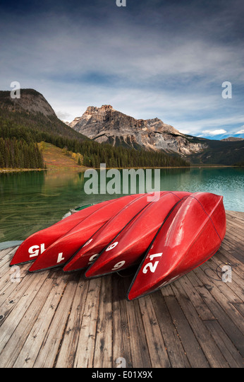 Red Canoes at Emerald Lake Canada - Stock Image