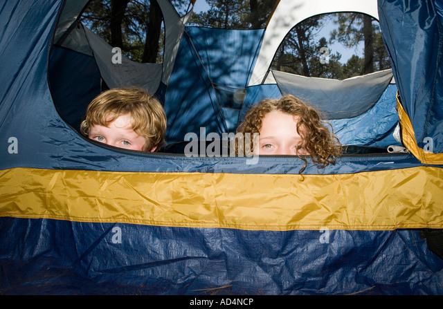 Two boys hiding in a tent - Stock-Bilder