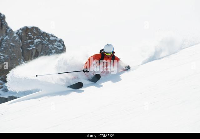Austria, Kleinwalsertal, Man skiing, low angle view - Stock Image