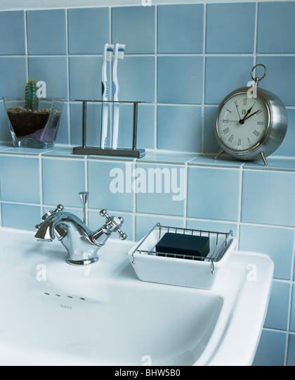 Close up of alarm clock and toothbrushes on shelf above bathroom basin in pale blue. Clock Bathroom Stock Photos  amp  Clock Bathroom Stock Images   Alamy