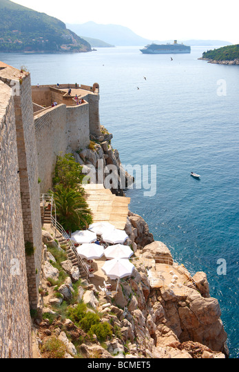 Dubrovnik City walls and Cruise liner - Croatia - Stock Image