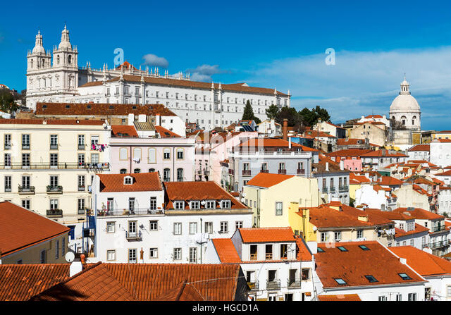View of the Alfama Neighborhood in Lisbon, Portugal, with colorful buildings and the National Pantheon - Stock-Bilder