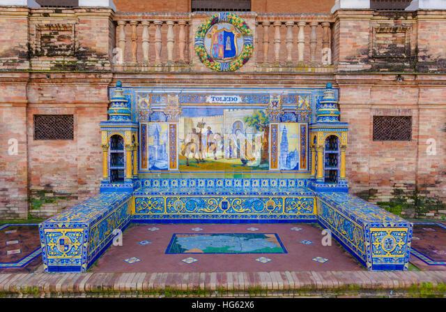 Glazed tiles bench of spanish province of Toledo at Plaza de Espana, Seville, Spain - Stock Image