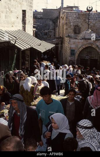 Israel Jerusalem Arab Quarters near Damascus Gate bazaar clothing - Stock Image