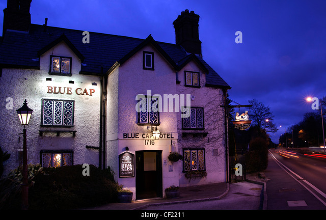 Blue Cap historic Pub and drinking place A556 at Dusk , Cheshire , England, United Kingdom - Stock Image