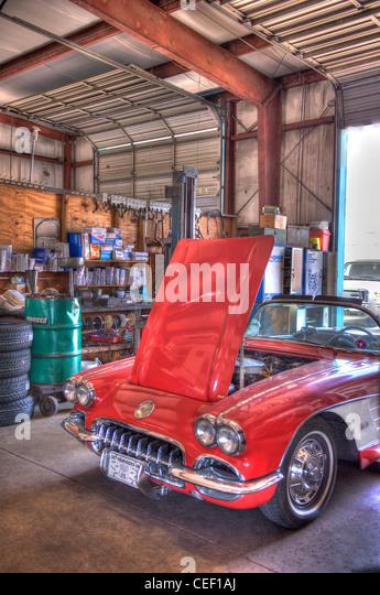 Vintage Red Chevrolet Corvette in garage - Stock Image