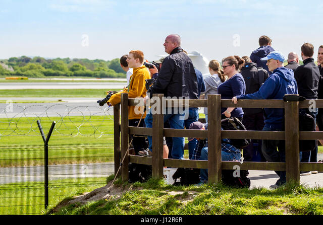 Planespotters watching aircraft at Manchester Airport Aviation Viewing Park - Stock Image