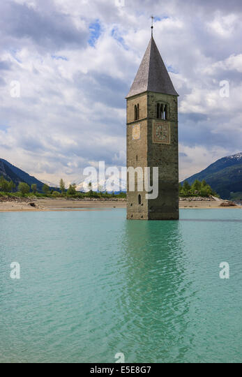 The bell tower in Reschensee, at the border of Italy and Austria - Stock Image