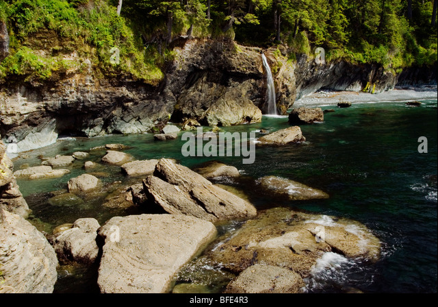 A waterfal, near Sombrio Beach on the Juan de Fuca Marine Trail, Vancouver Island, British Columbia, Canada - Stock Image