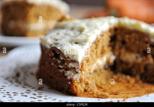 Carrot cake on a white plate - Stock Image