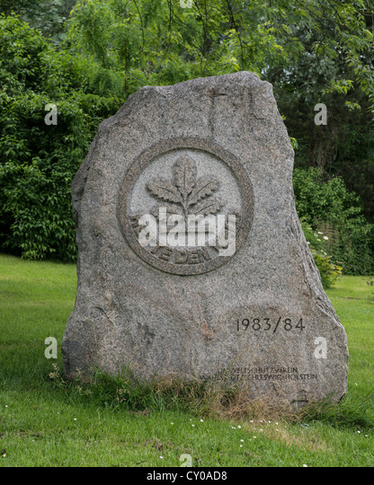 Stone relief 'Rette den Wald', German for 'save the forest', oak sapling, symbol of the actions - Stock Image