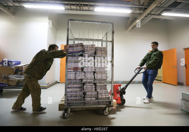 Moscow, Russia. 27th Mar, 2017. Workers handle stacked documents at the Russian Book Chamber. Credit: Vyacheslav - Stock Image