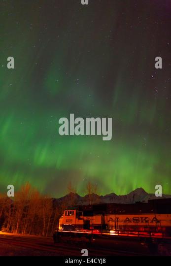 Aurora borealis over the Alaska Railroad, Seward, Alaska. - Stock Image