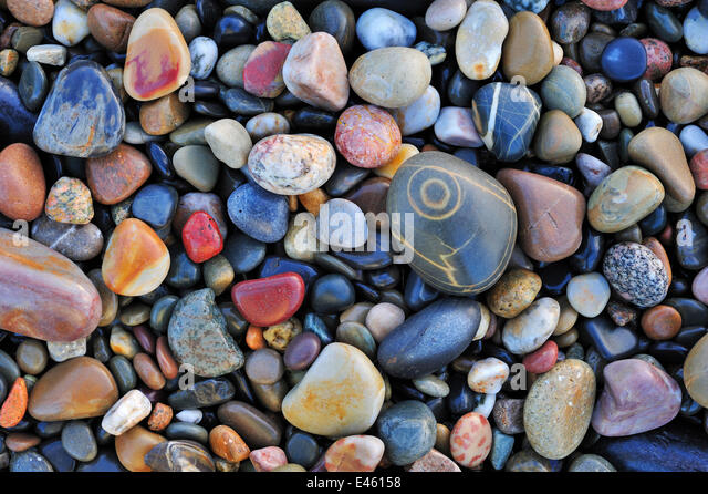Colourful water-smoothed pebbles on shingle beach. Normandy, France, October 2010. - Stock Image