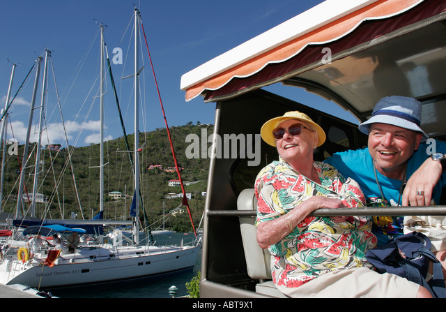 BVI Tortola Frenchmans Cay couple tour vehicle Soper's Hole Wharf and Marina - Stock Image