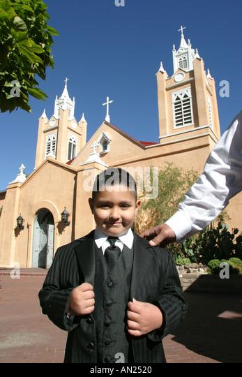 Albuquerque New Mexico Old Town San Felipe de Neri Church young boy male prior to wedding - Stock Image