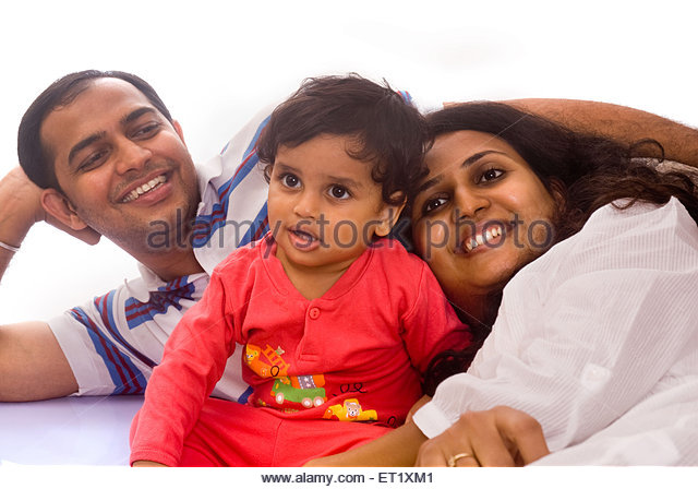 Happy complete family father, mother and one year baby boy isolated on white background - Stock Image