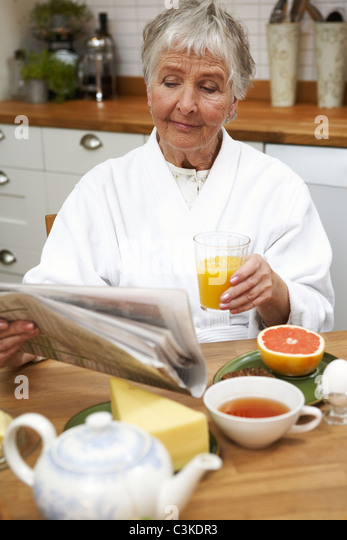 An elderly woman having breakfast, Sweden. - Stock-Bilder
