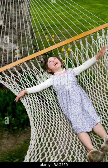 Young girl laying on a hamock Pemperton British Columbia Canada - Stock Image