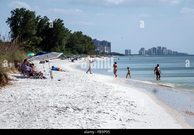 Naples Florida Delnor-Wiggins Pass State Park Gulf of Mexico sand beach sunbathers - Stock Image
