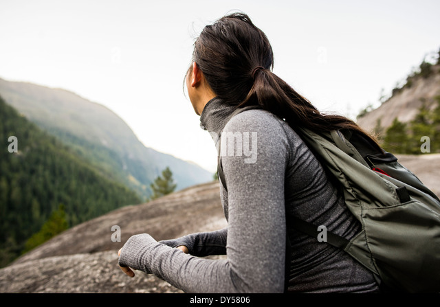 Young woman looking at view, Squamish, British Columbia, Canada - Stock Image