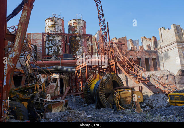 Disney Studios tram tour through Catastrophe Canyon showing studio sets used for production of films Including floods - Stock Image