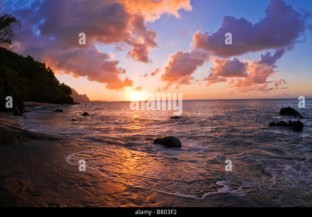 Sunset and the Na Pali Coast from Hideaways Beach Island of Kauai Hawaii - Stock Image