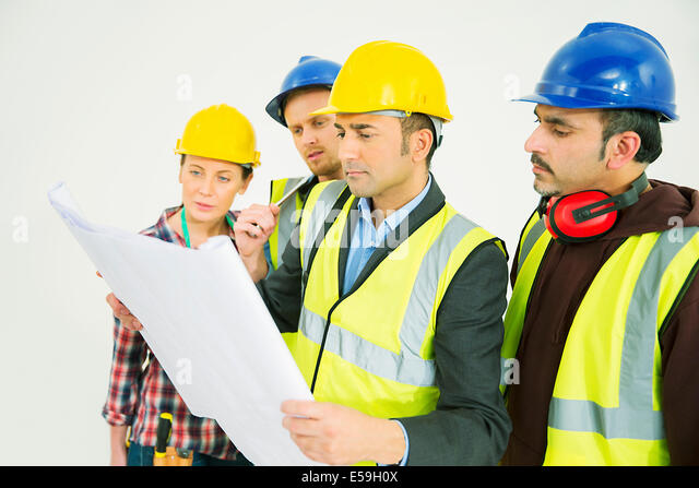 Construction workers viewing blueprints - Stock Image