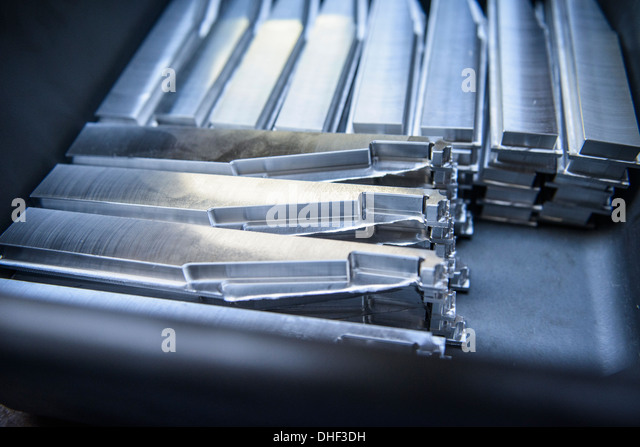 Stacks of unfinished engineering components in factory, close up - Stock Image