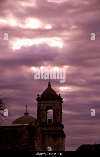 Mission San Jose bell tower san antonio texas tx early morning dramatic purple sky silo silhouette - Stock Image