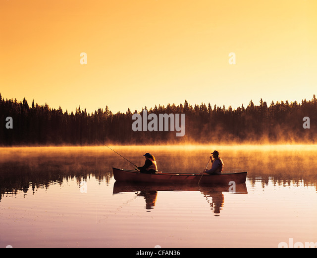 Couple canoeing and fishing, Perch Lake, Duck Mountain Provincial Park, Manitoba, Canada - Stock Image