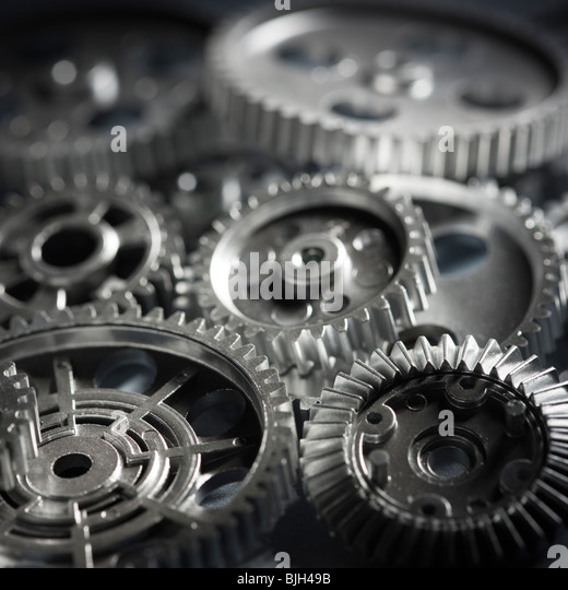 gears piled on top of gears - Stock Image