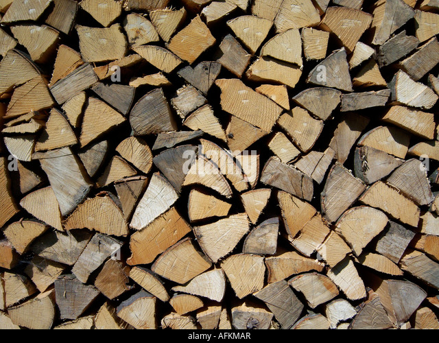 ends of stacked split firewood. Photo by Willy Matheisl - Stock Image
